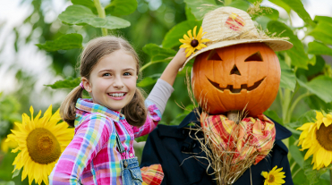 Scarecrow and happy girl