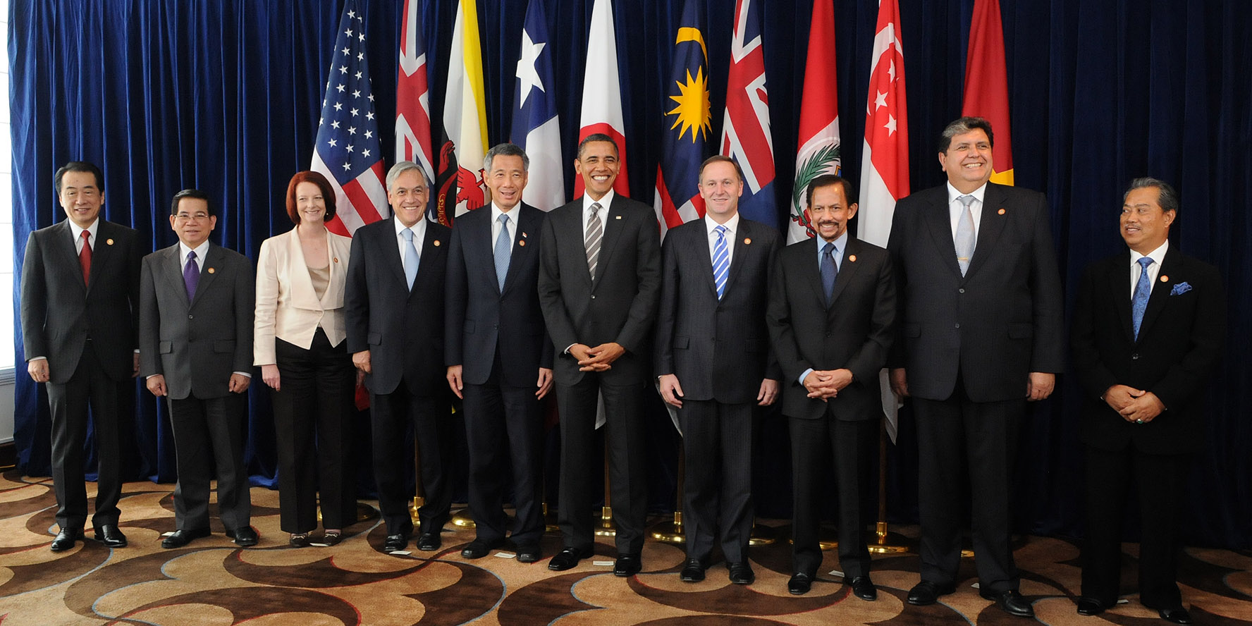 Architects of treason or enlightened leaders? (Photo from 2010 TPP meeting) From left, Naoto Kan (Japan), Nguyễn Minh Triết (Vietnam), Julia Gillard (Australia), Sebastián Piñera (Chile), Lee Hsien Loong (Singapore), Barack Obama (U.S.), John Key (New Zealand), Hassanal Bolkiah (Brunei), Alan García (Peru), and Muhyiddin Yassin (Malaysia).